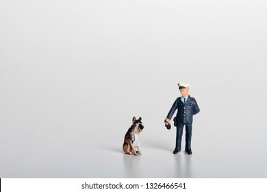 miniature of a cop and a drug police dog