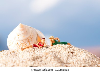 Miniature couple an a beach in vintage swimming costume