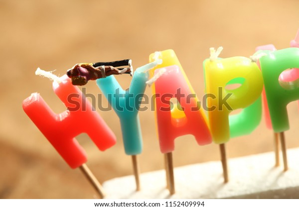 Miniature couple model and birthday candle scene.