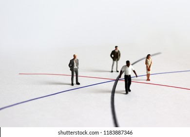 Miniature diverse people standing on different line.