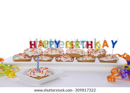 Miniature Donut Cake For First Birthday Party With Happy Multicolored Candles Partially Isolated