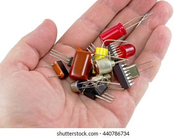 Miniature elctronic circuit board on hand on white background