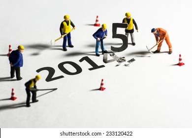 Miniature engineer or technician change represents the new year 2014 - 2015