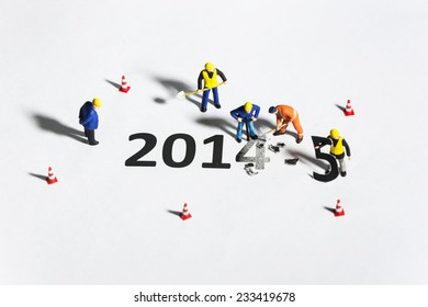 Miniature engineer or technician change represents the new year 2014- 2015