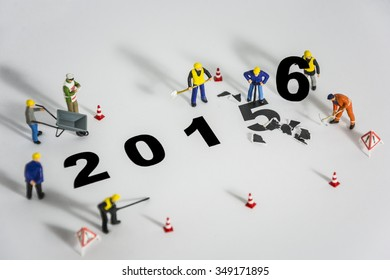 Miniature engineer or technician change represents the new year 2015- 2016