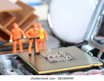 Miniature engineer or technician repairing CPU , Technology concept