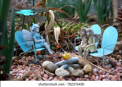 Miniature Fairies in a Rock Garden