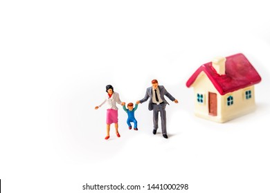 miniature family with father,mother ,son and miniature house with red roof isolated on white background .Image for property real estate investment concept or happy family  concept.