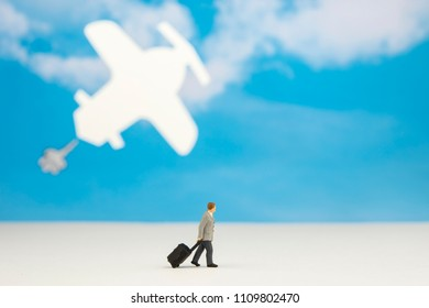Miniature figure of business man who going to airport