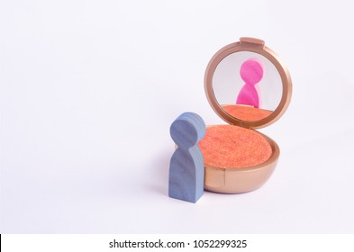 A miniature figure of a man looks in the mirror and sees his hatching in another gender. The concept of gender identity. Transgender, gay lesbian person. Sex education, inequality and gender equality
