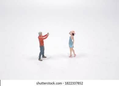 a Miniature figure people , Photographer to take a photo for girl
