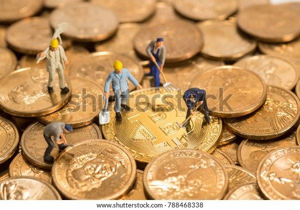 miniature figure people working on Cryptocurrency golden bitcoin and dollars coin money