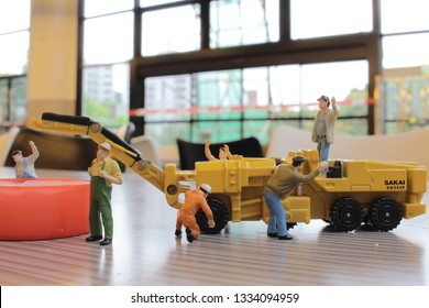 the Miniature figure of technicians working