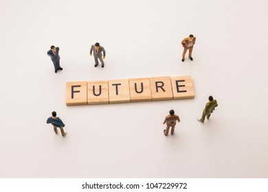 Miniature figures businessman : meeting on future letters by wooden block word on white paper background, in concept of business and corporation