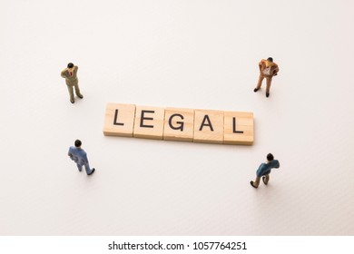 Miniature figures businessman : meeting on legal letters by wooden block word on white paper background, in concept of business and corporation