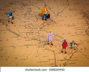 Miniature figures of people on Latin America's map. They are running away from their home in search of security and a better life.