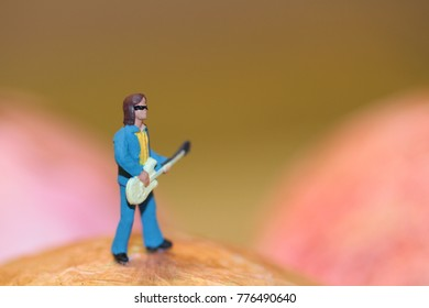 miniature figurine of a guitarist