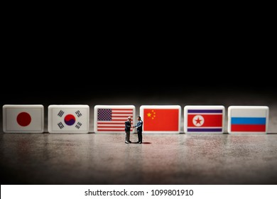 Miniature figurine with national flags
