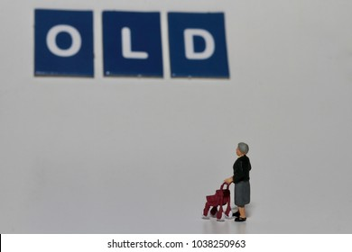 miniature figurine of an old woman with a walker