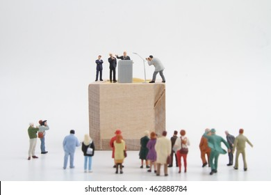 miniature figurine of a politician peaking to the people during an election rally