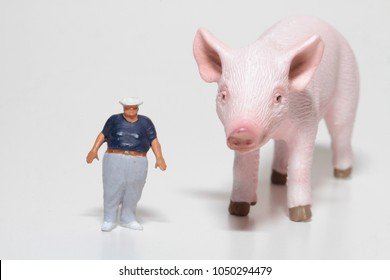 miniature figurines of a fat man with a pig