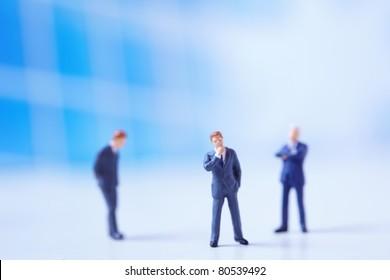 Miniature figurines of successful business team.