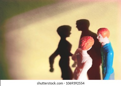 Miniature, generic man and woman. Toy couple representing dating, romance or marriage. Basic white couple attempting love. Instagram filter and shadows.