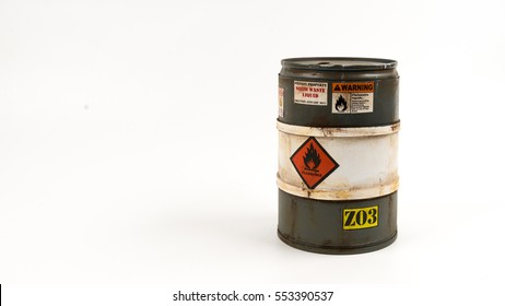 Miniature of grey color barrel or flammable drum. Concept of dangerous or explosive material. Isolated on white background. Slightly de-focused and close-up shot. Copy space.