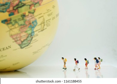 Miniature Group of Student walking to  the big world use as new technology social network , study aboard and education concept.