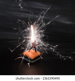Miniature guitar solo man on black electric lightening background.Rock music and pyrotechnics concept.Little dude makes a big sound. Musician jamming is having a blast creating high energy loud music.