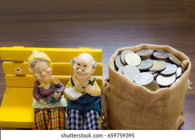 Miniature happy senior couple with savings coins. Show growth asset investment, Retirement plan, Pension fund and 401K, Passive income, Wage,Millionaire, Financial freedom and wealth, Benefit concept.