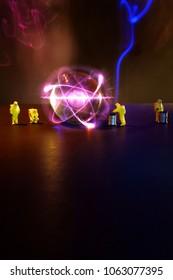 Miniature hazmat team inspect radioactive atomic particle
