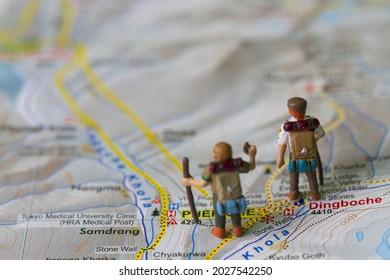 Miniature hikers on map of Nepal everest region