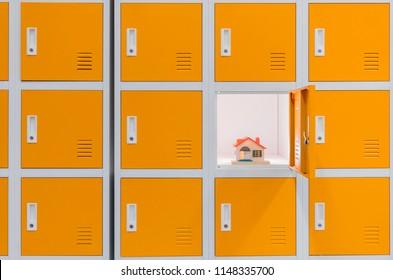 a miniature of a house inside orange locker