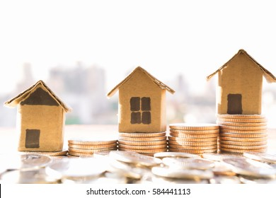 Miniature house model and Financial statement with coins. Finance and house loan, saving money for a house or material design  concepts.