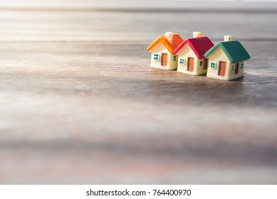 Miniature house on wooden background.Image for property real estate