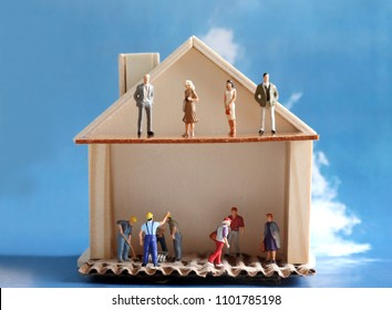 Miniature houses and miniature people. The concept of income disparity in modern society.