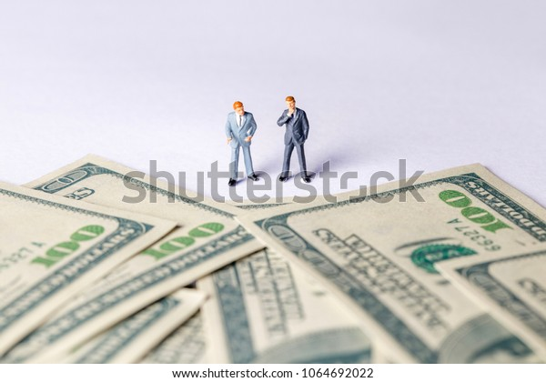 Miniature of investor man looking to money. Business and Investment concept.