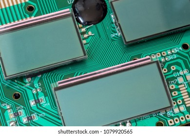 Miniature LCD panels on the motherboard. Circuit Board close-up. Detail of an electronic printed circuit board with mounted display screen.
