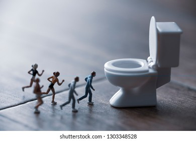 miniature man who runs to a restroom