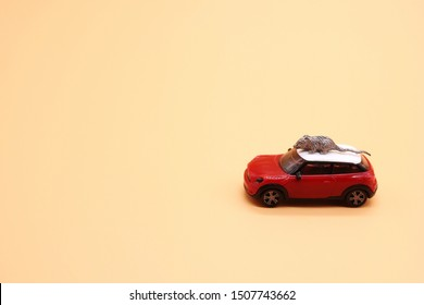 Miniature metal souvenir rat on the roof of a toy car. Symbol of the new year 2020. Copy space.