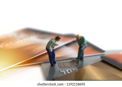 miniature mini figures digging chip Credit Cards Theft Concept. Hacker steal Credit Cards  information on ship card Usecurity  For Unauthorized Shopping. Unauthorized Payments on white background
