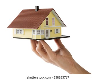 Miniature model house in female hand isolated on white background, for house development concept.