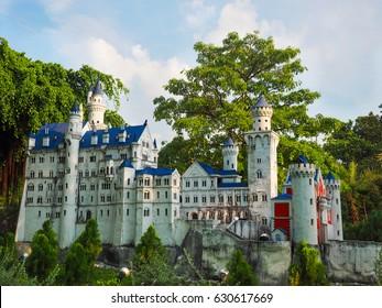 Miniature model of Neuschwanstein castle in forest