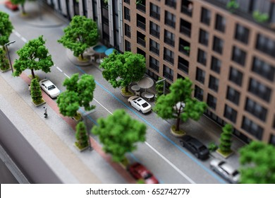 Miniature model, miniature toy buildings, cars and people. City maquette.