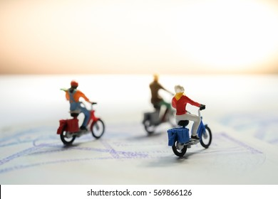Miniature motorcycle / bigbike people riding passport book with copyspace, Travel around the world, explore the earth, adventure trip and travels insurance background Concept.
