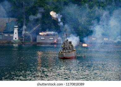 Miniature naval battle ship firing on enemy at Peasholm Park Naval Warfare Battle in Scarborough, UK