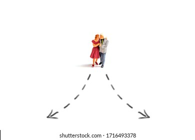 miniature old couple with arrow line isolated on white background.