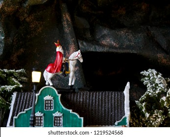 "Miniature: old man on a white horse on the roof of a house. Dutch tradition ""Sinterklaas"""