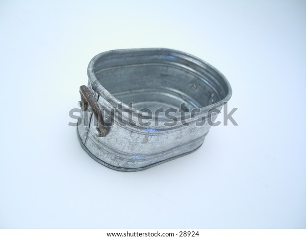 A miniature pail on a white background.